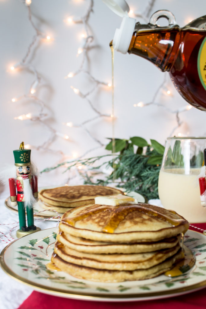Swing in the Christmas season with these easy, fluffy, delicious eggnog pancakes and some nutmeg to top!  www.passthecookies.com