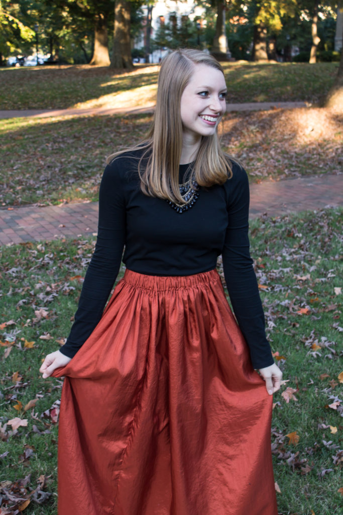 Pairing a simple black top with a fun burnt orange maxi skirt a statement necklace, and classic leopard flats is an easy way to create a great Halloween or fall outfit.  www.passthecookies.com
