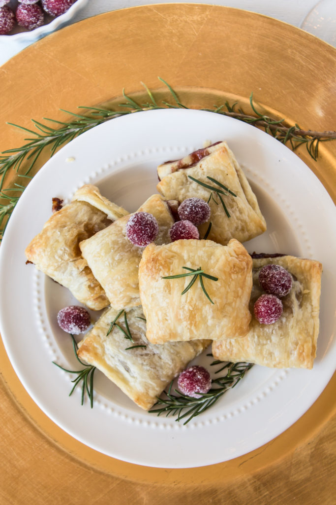Golden and flaky with gooey cheese and sweet jam, baked brie bites are quick, easy, and delicious, but look sophisticated at your appetizer spread.  www.passthecookies.com