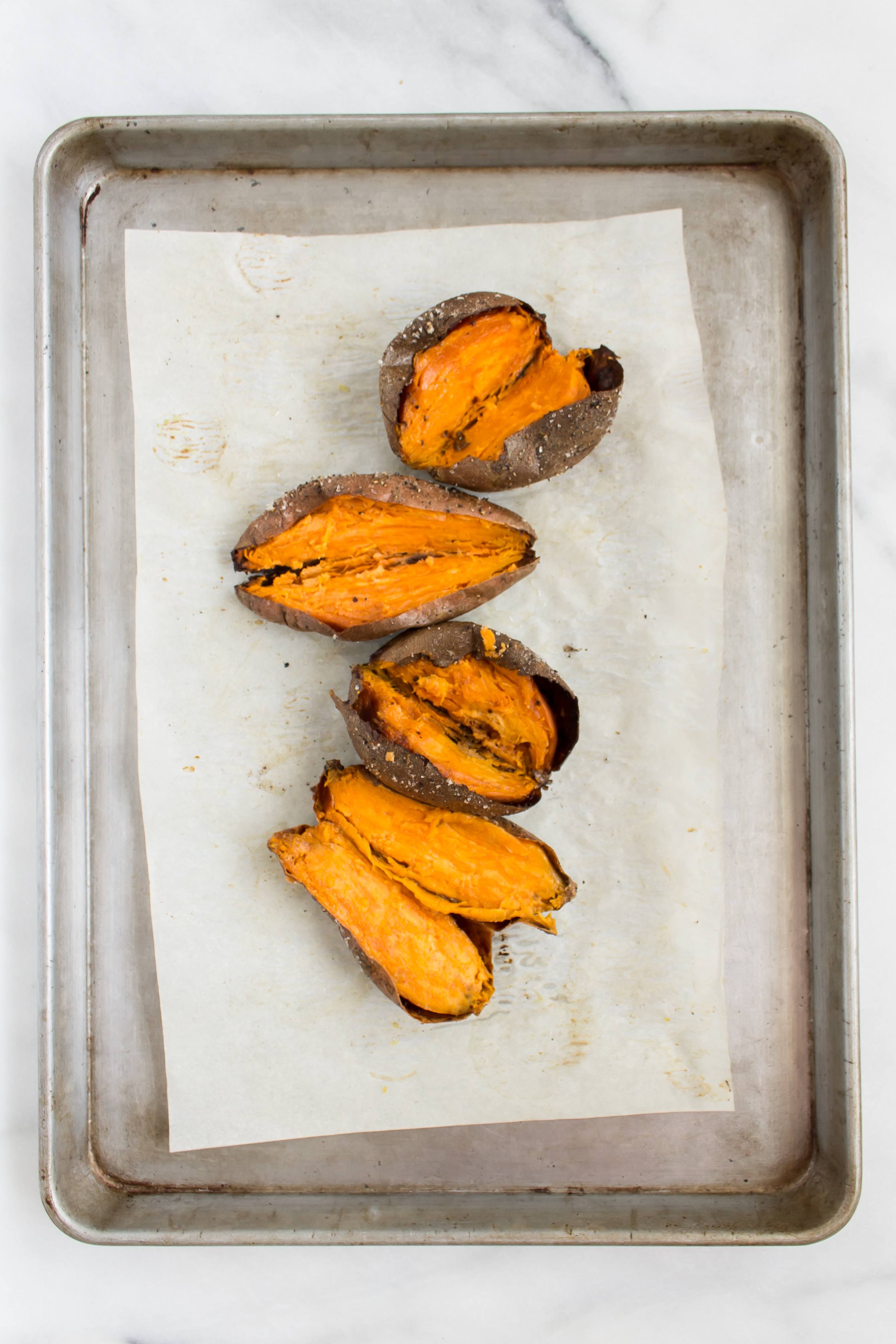 slow roasted sweet potatoes with spiced maple pecans and maple bourbon butter
