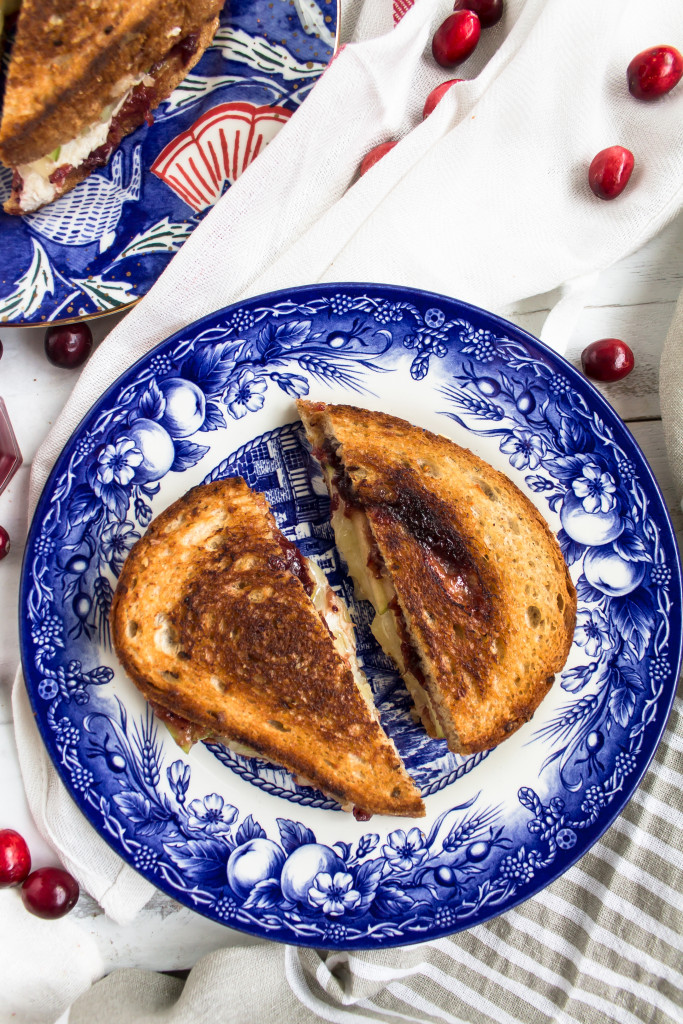 Filled with turkey, sweet cranberry sauce, tart apple slices, dijon, and gruyere, this Thanksgiving leftovers grilled cheese is easy, delicious and perfect for your day-after lunch. | Pass the Cookies | www.passthecookies.com