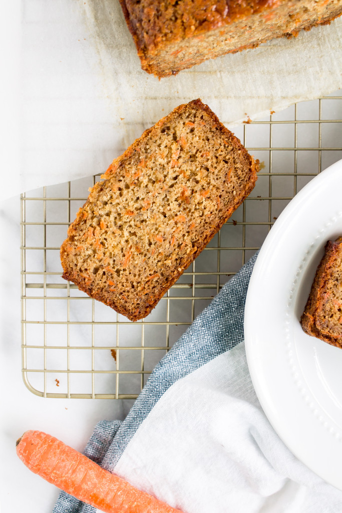 This healthier carrot cake banana bread is the perfect cross between indulgent carrot cake and moist, delicious familiar banana bread and makes a great spring breakfast or snack. | Pass the Cookies | www.passthecookies.com