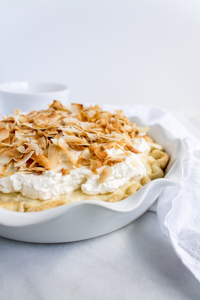 This classic coconut cream pie has a perfectly flaky crust, rich, coconut pastry cream filling, fluffy homemade whipped cream, golden-toasted coconut, and a side of good 'ol nostalgia. | Pass the Cookies | www.passthecookies.com