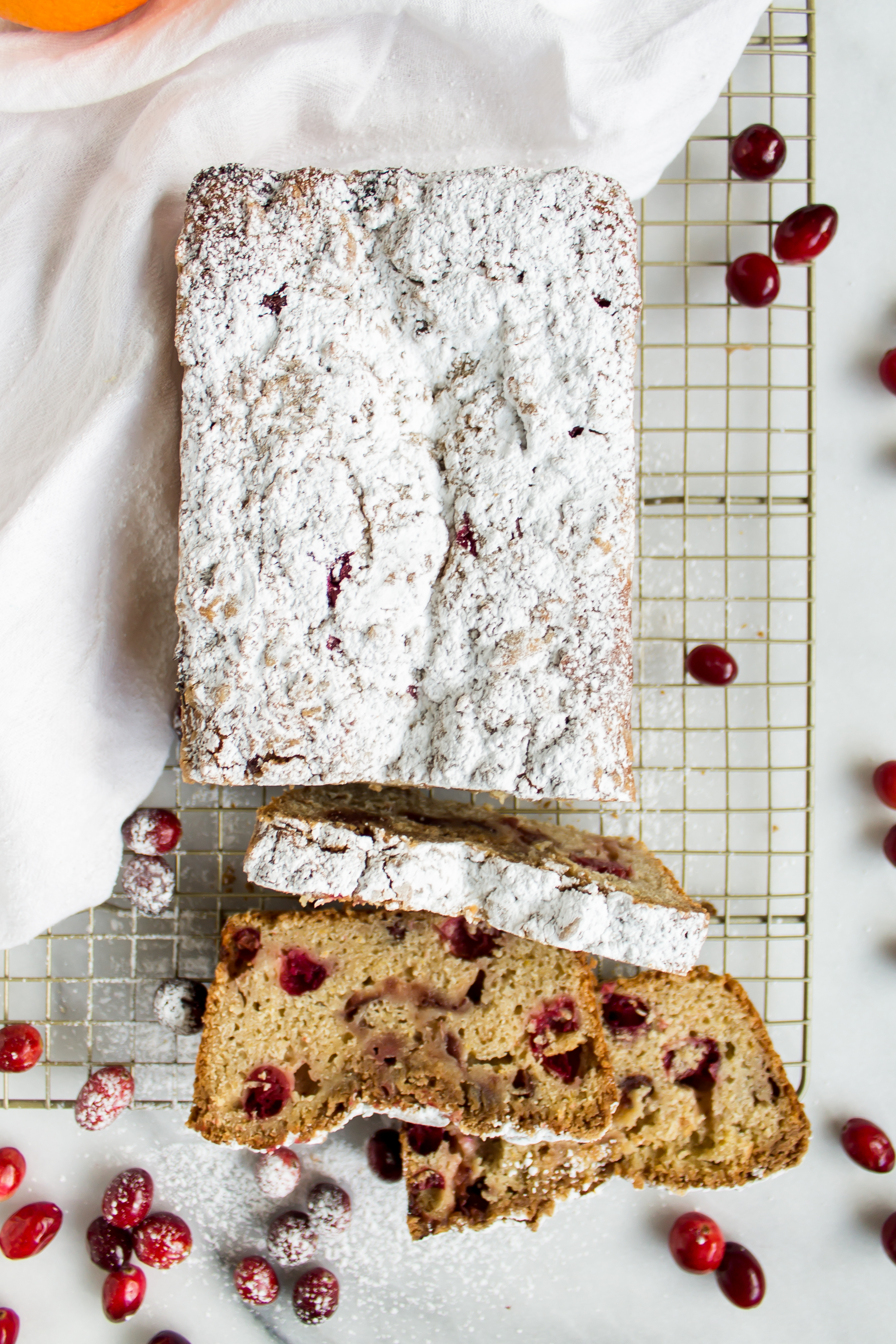 Cranberry quick bread is the perfect double duty bread! Make it for breakfast on Thanksgiving morning or use your leftover cranberry sauce to make a loaf for post-Thanksgiving enjoyment. | www.passthecookies.com
