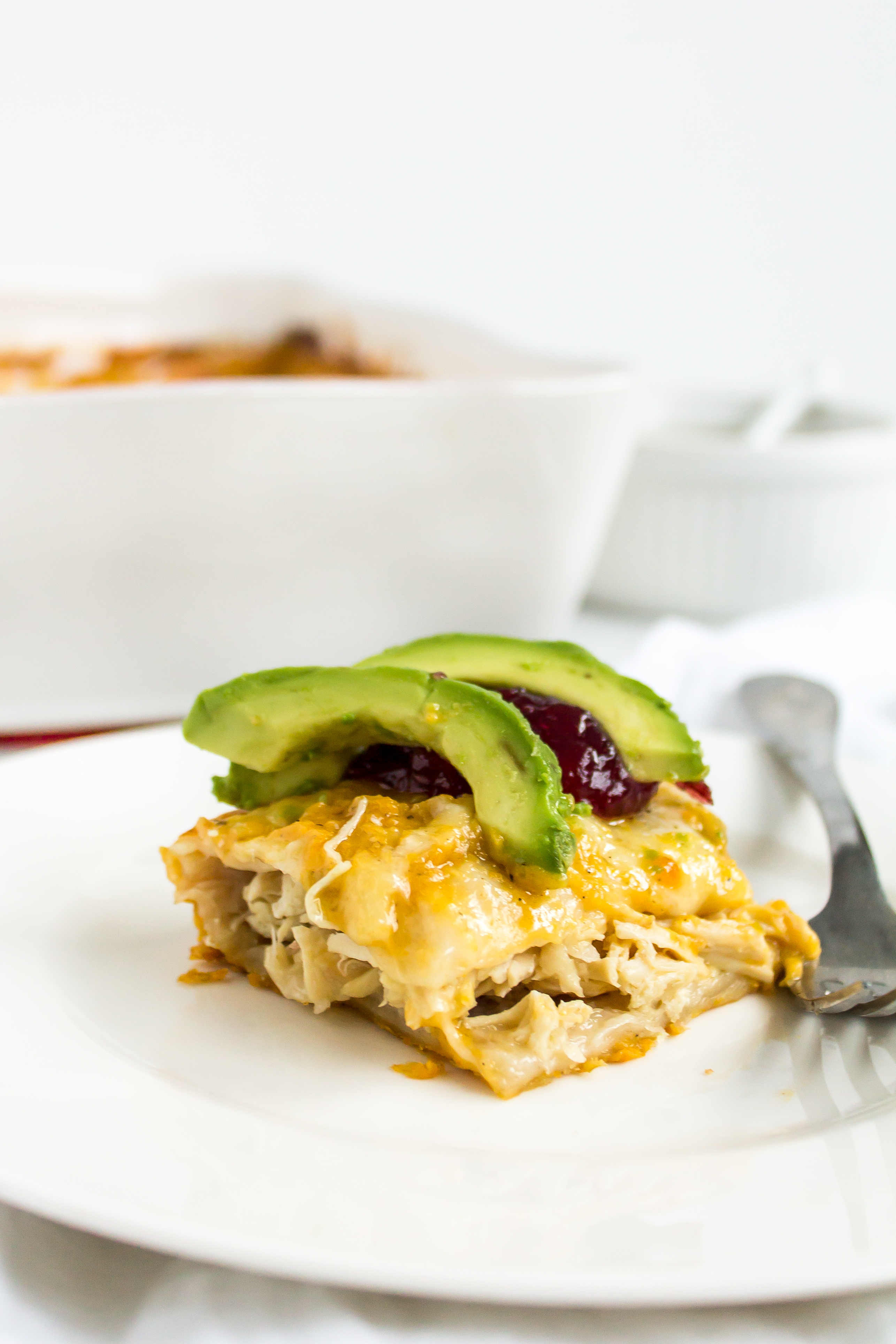 Turkey enchiladas with butternut squash sauce are the perfect way to use up Thanksgiving leftovers! | www.passthecookies.com