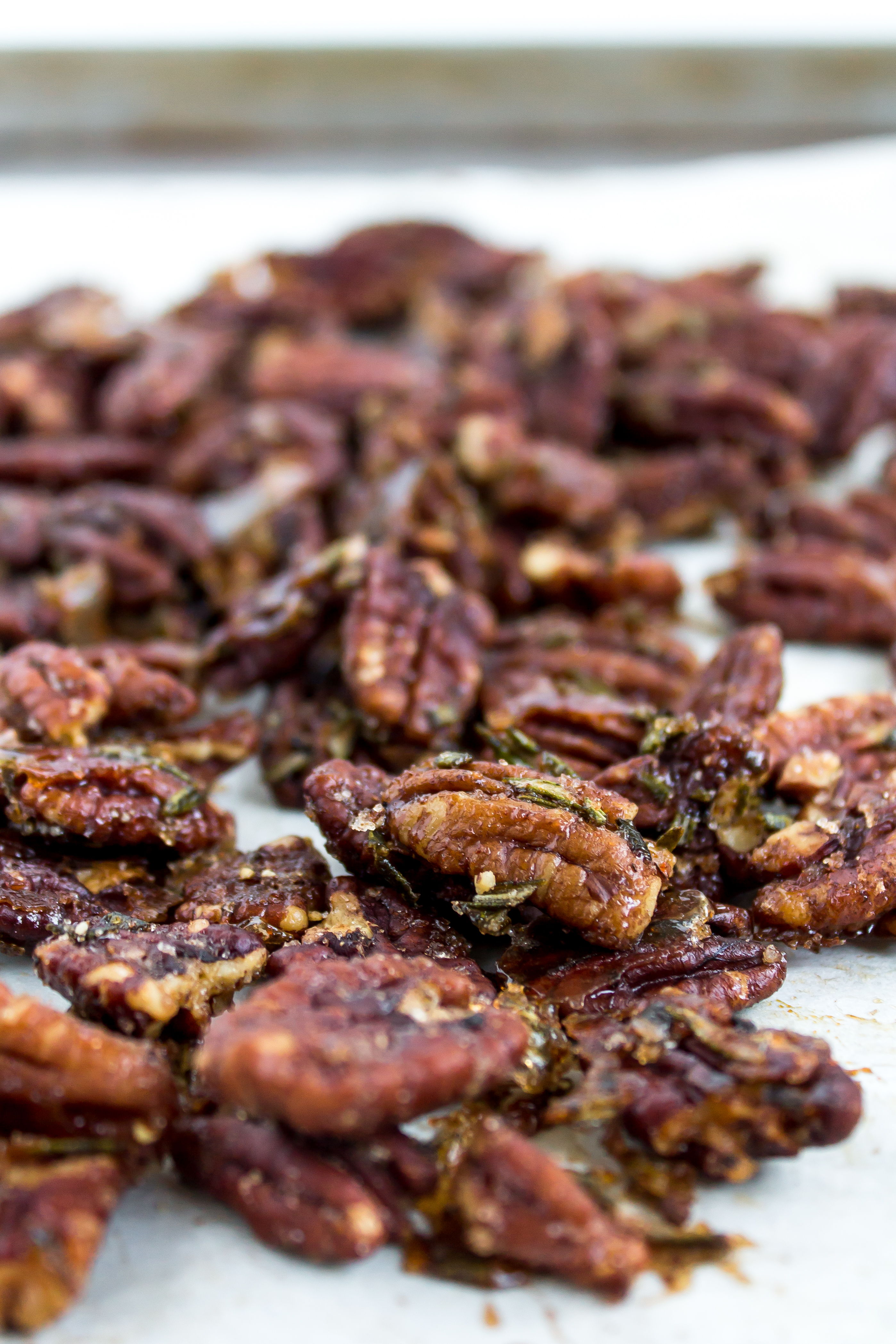Rosemary spiced pecans are the perfect sweet and salty snack for your appetizer board. With their deliciously addictive flavor, everyone will ask you for this recipe. | Pass the Cookies | www.passthecookies.com