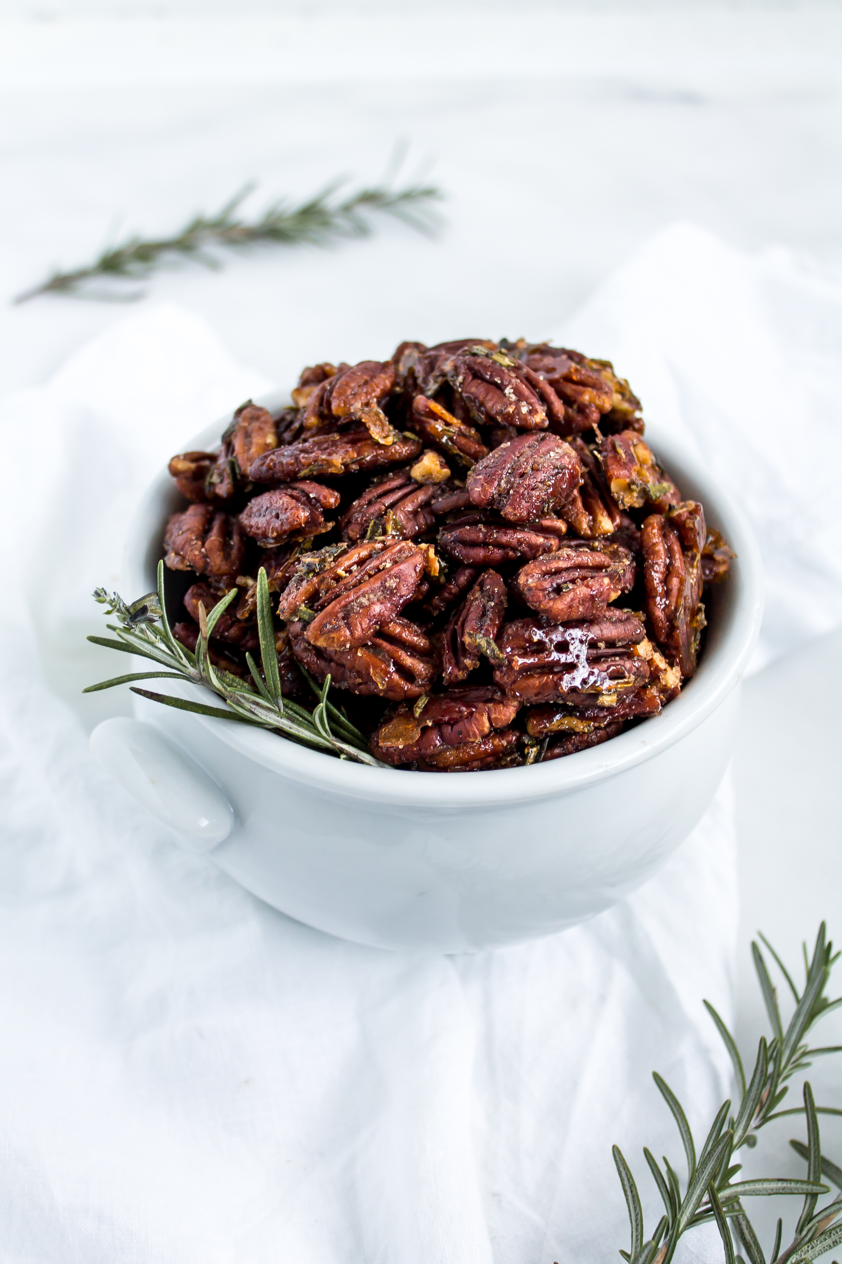 Rosemary spiced pecans are the perfect sweet and salty snack for your appetizer board. With their deliciously addictive flavor, everyone will ask you for this recipe.   Pass the Cookies   www.passthecookies.com