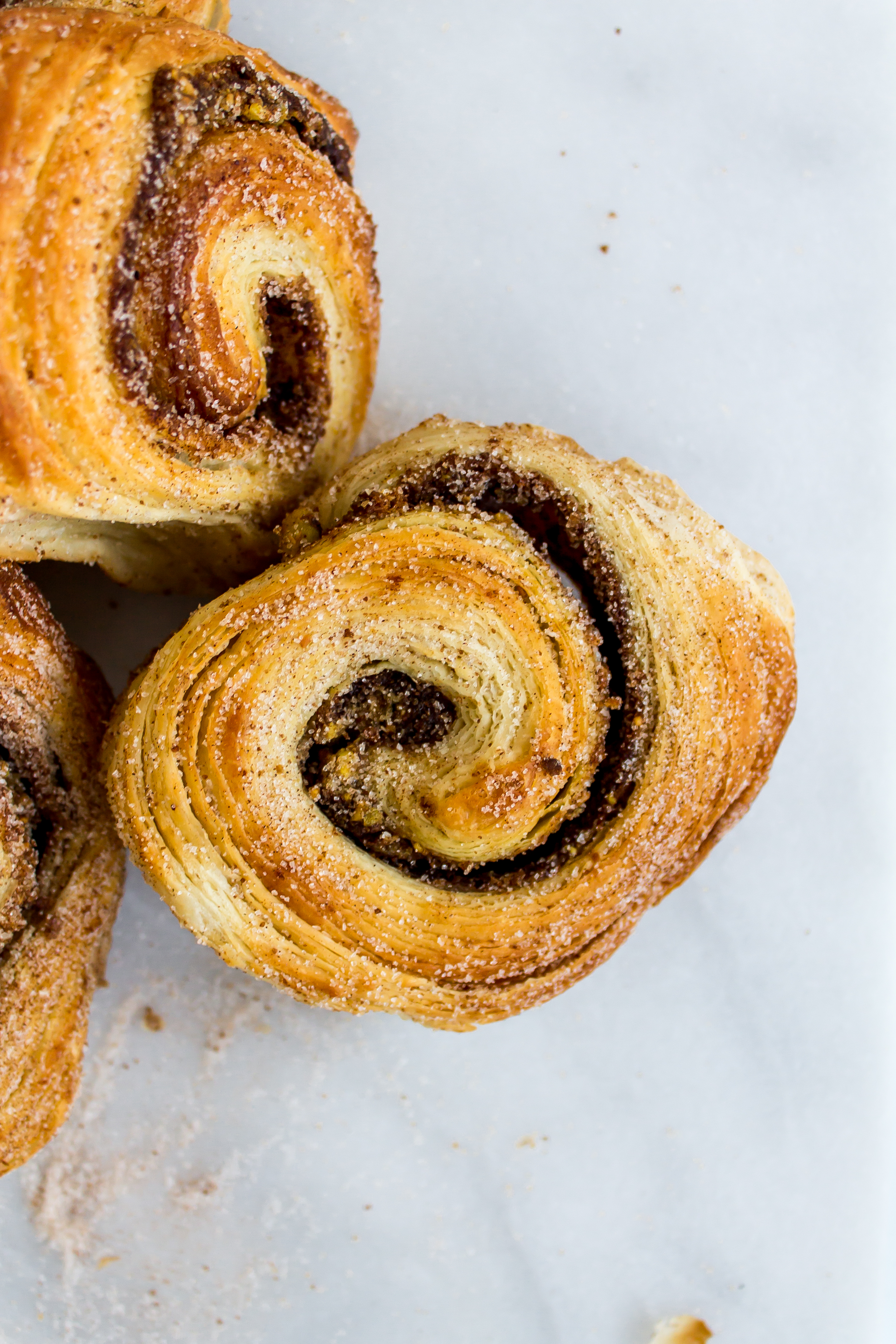 These incredibly flaky and delicious pistachio morning buns are worth the wait!   Pass the Cookies   www.passthecookies.com