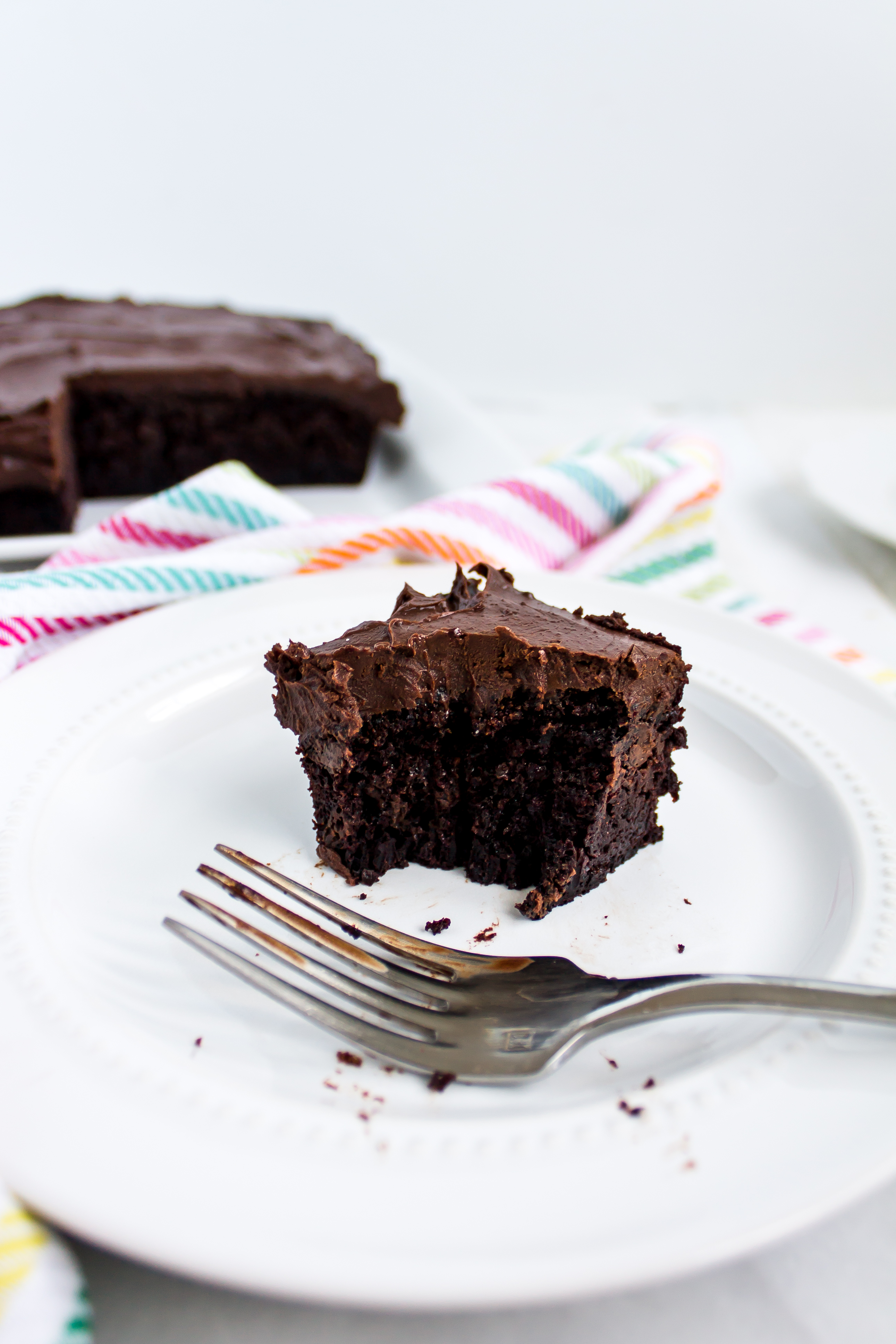One bowl whiskey chocolate cake with decadent Irish cream chocolate ganache frosting is the perfect snack cake for St. Patrick's Day, or just your next picnic. It is easy and sure to be a crowd pleaser. | www.passthecookies.com