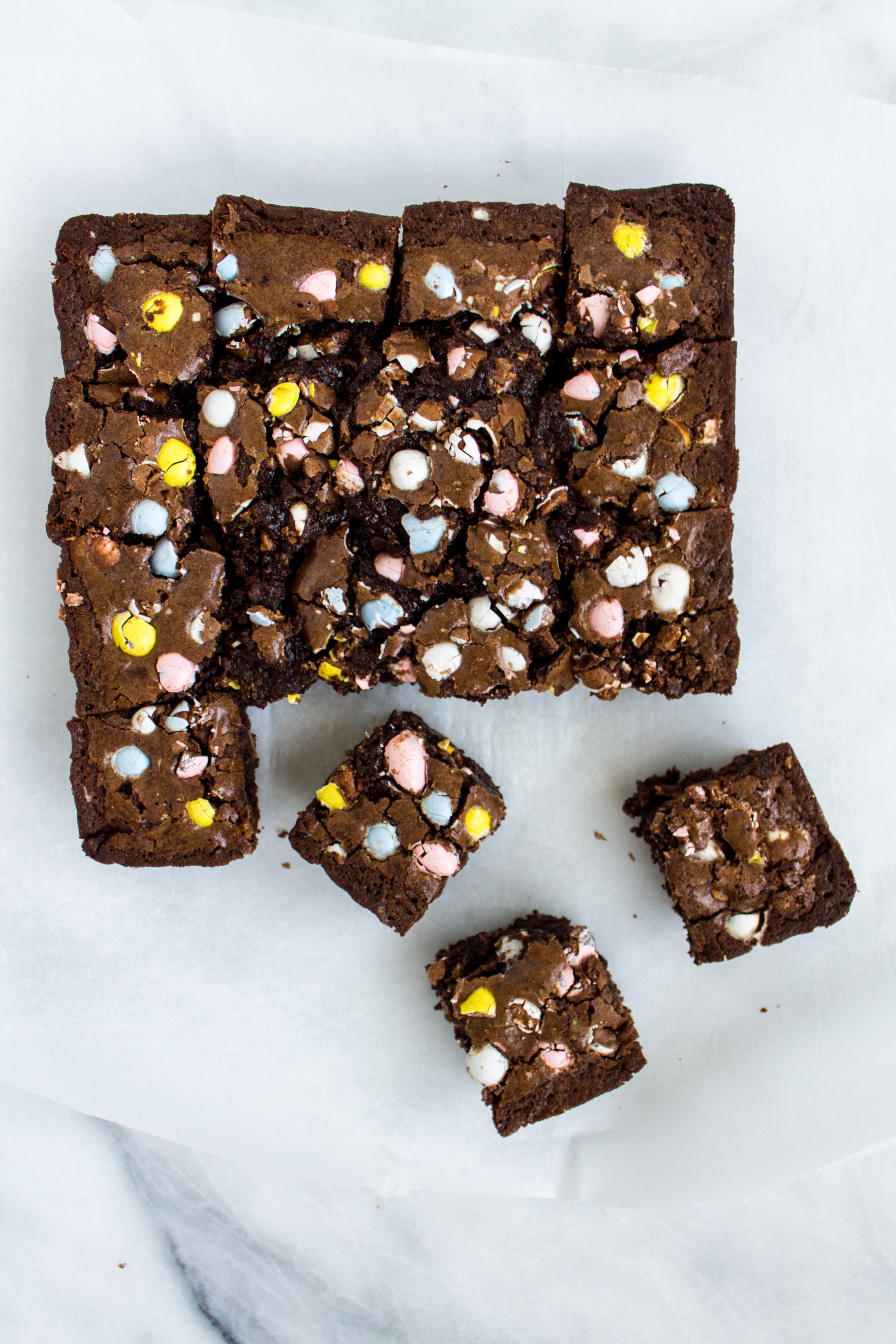 These fudgy, decadent Cadbury mini egg brownies are the perfect treat for Easter! They are easy to throw together, delicious, and good for snacking on even days later. | www.passthecookies.com