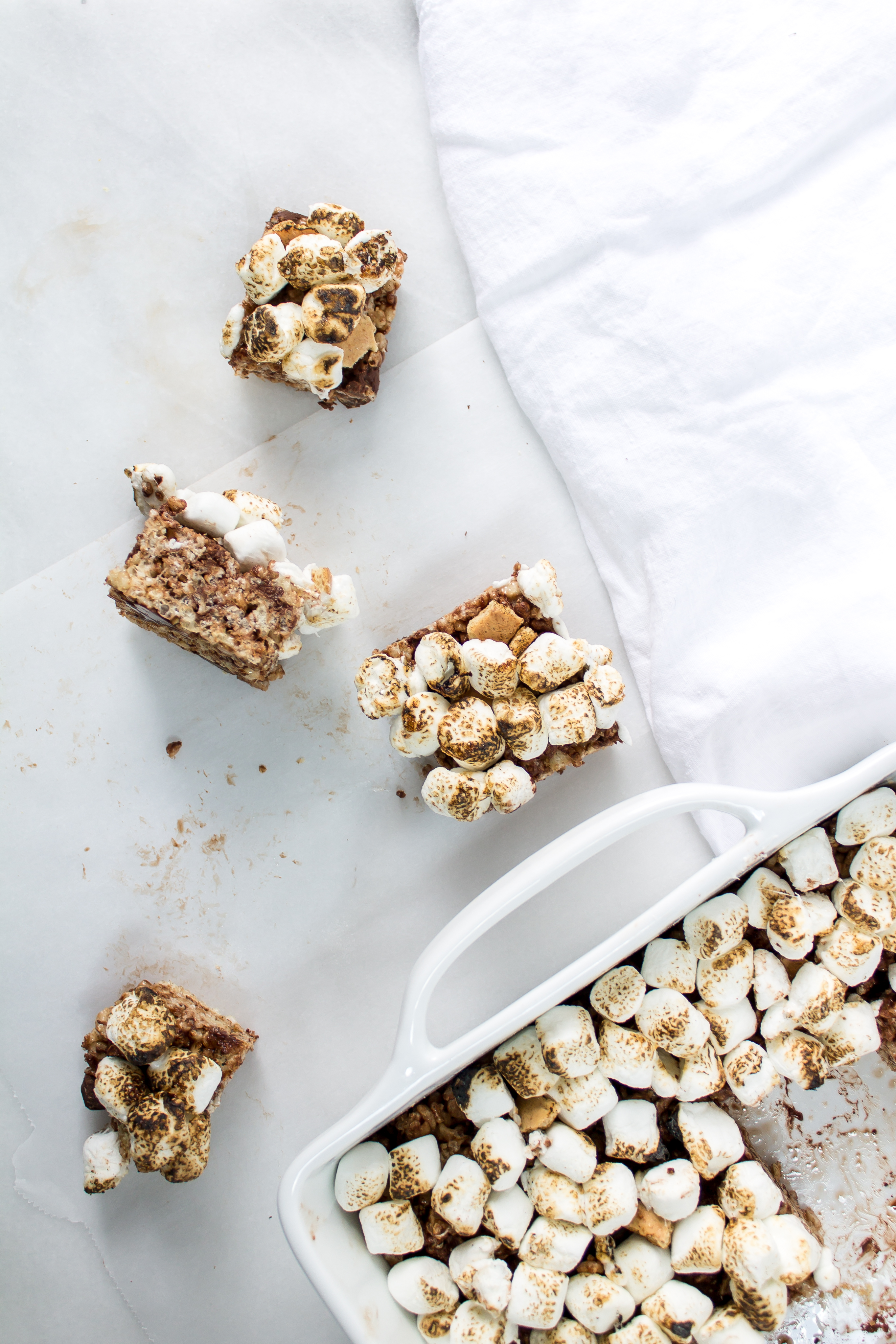 S'mores rice krispie treats are the easiest no-bake treat to make when you want that campfire s'mores taste without the hassle. | Pass the Cookies | www.passthecookies.com