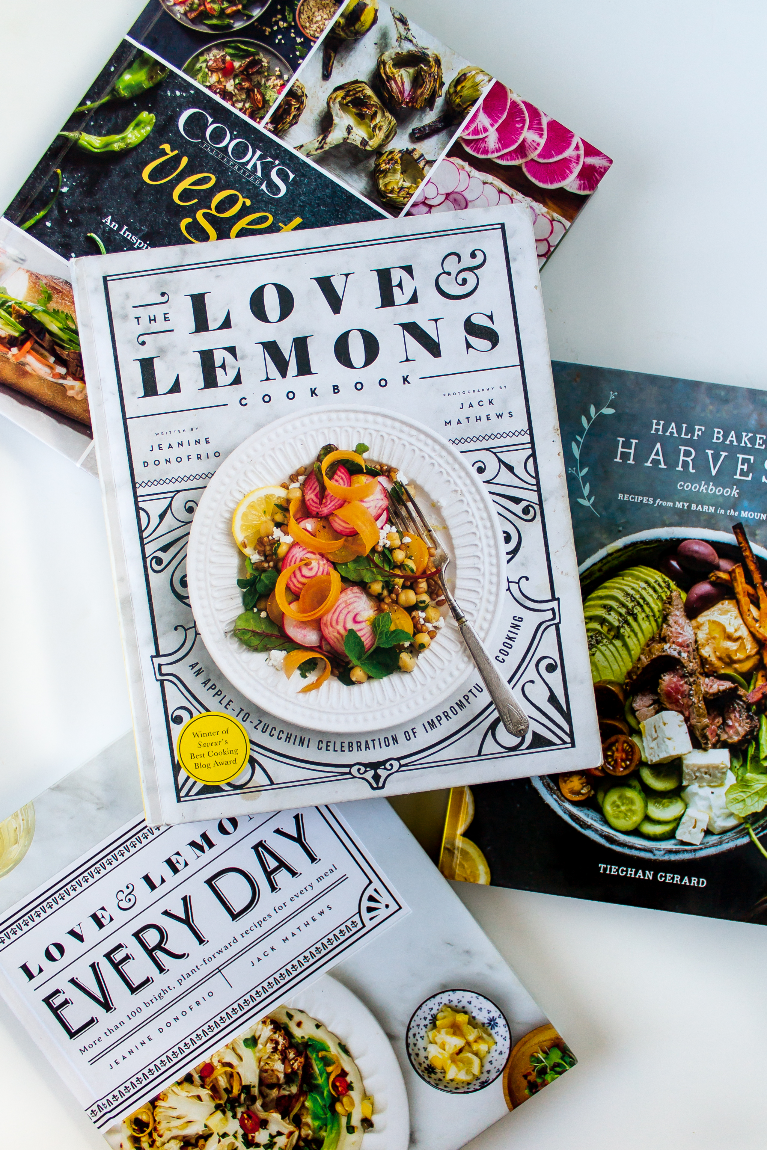 the 5 cookbooks that I'm loving this summer, and where I have been getting most of our dinner recipes. They are all vegetable heavy and filled with great fresh recipes to make all season long. | Pass the Cookies | www.passthecookies.com #cookbooks #summer #summercooking