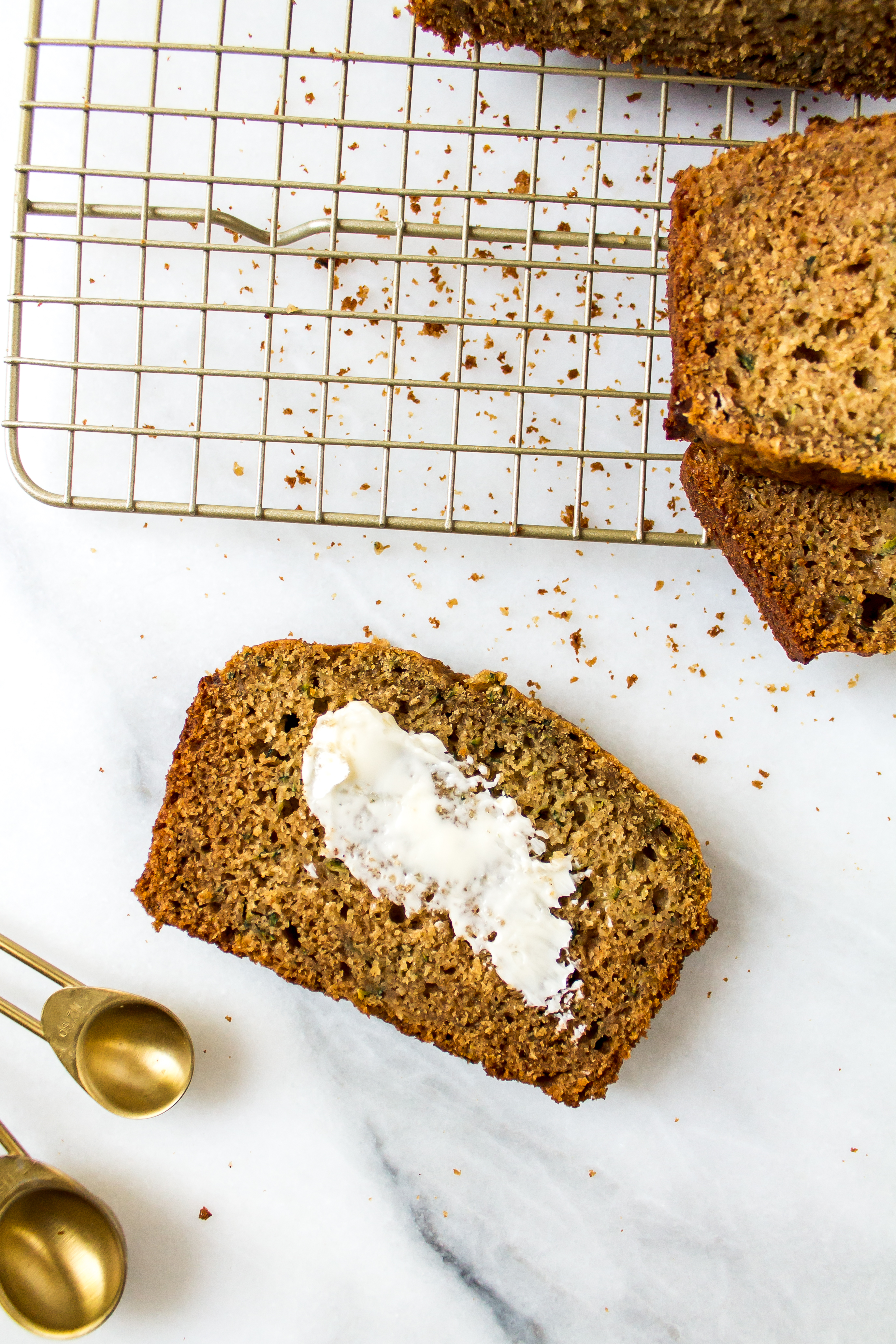 One-bowl healthy zucchini bread is an easy breakfast or afternoon treat. By the taste, you would never know it is filled with veggies! | Pass the Cookies | www.passthecookies.com