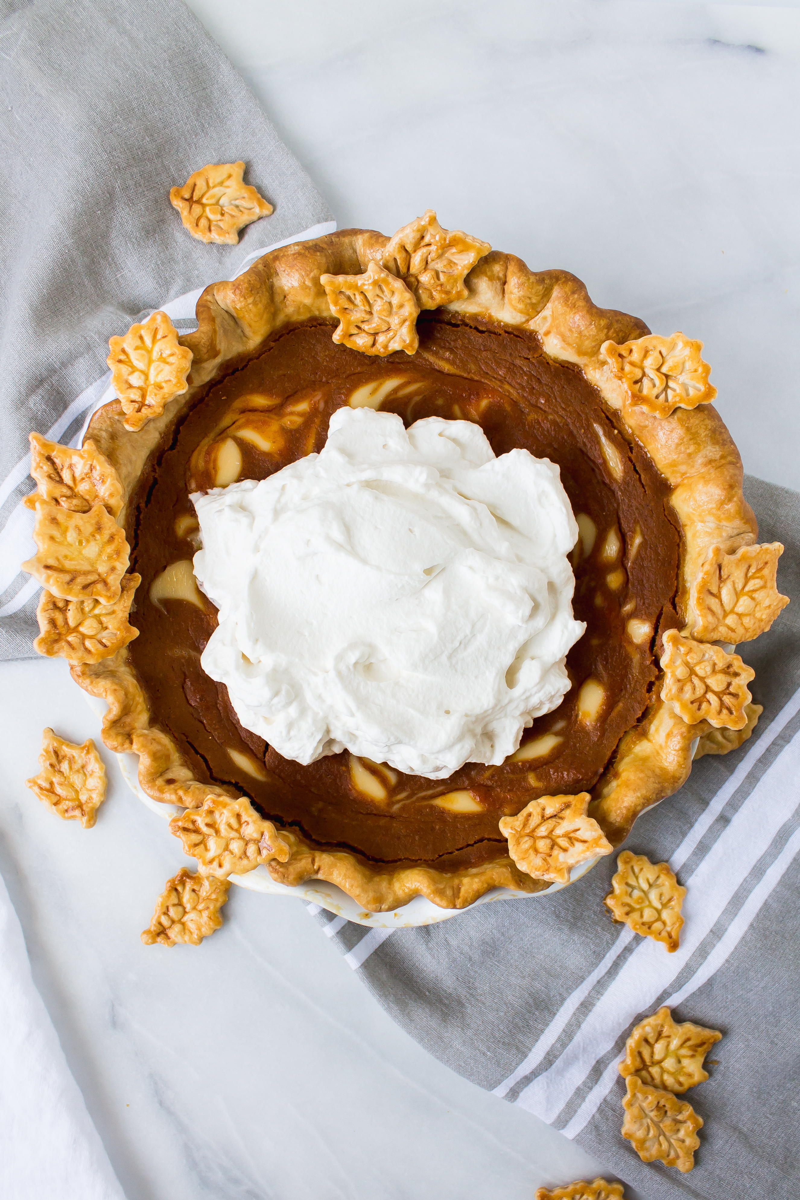 Buttermilk bourbon pumpkin pie has the smooth and custardy pumpkin we all know, with a little tang from buttermilk and creme fraiche. Make it throughout the fall, or display it on your Thanksgiving table. | Pass the Cookies | www.passthecookies.com