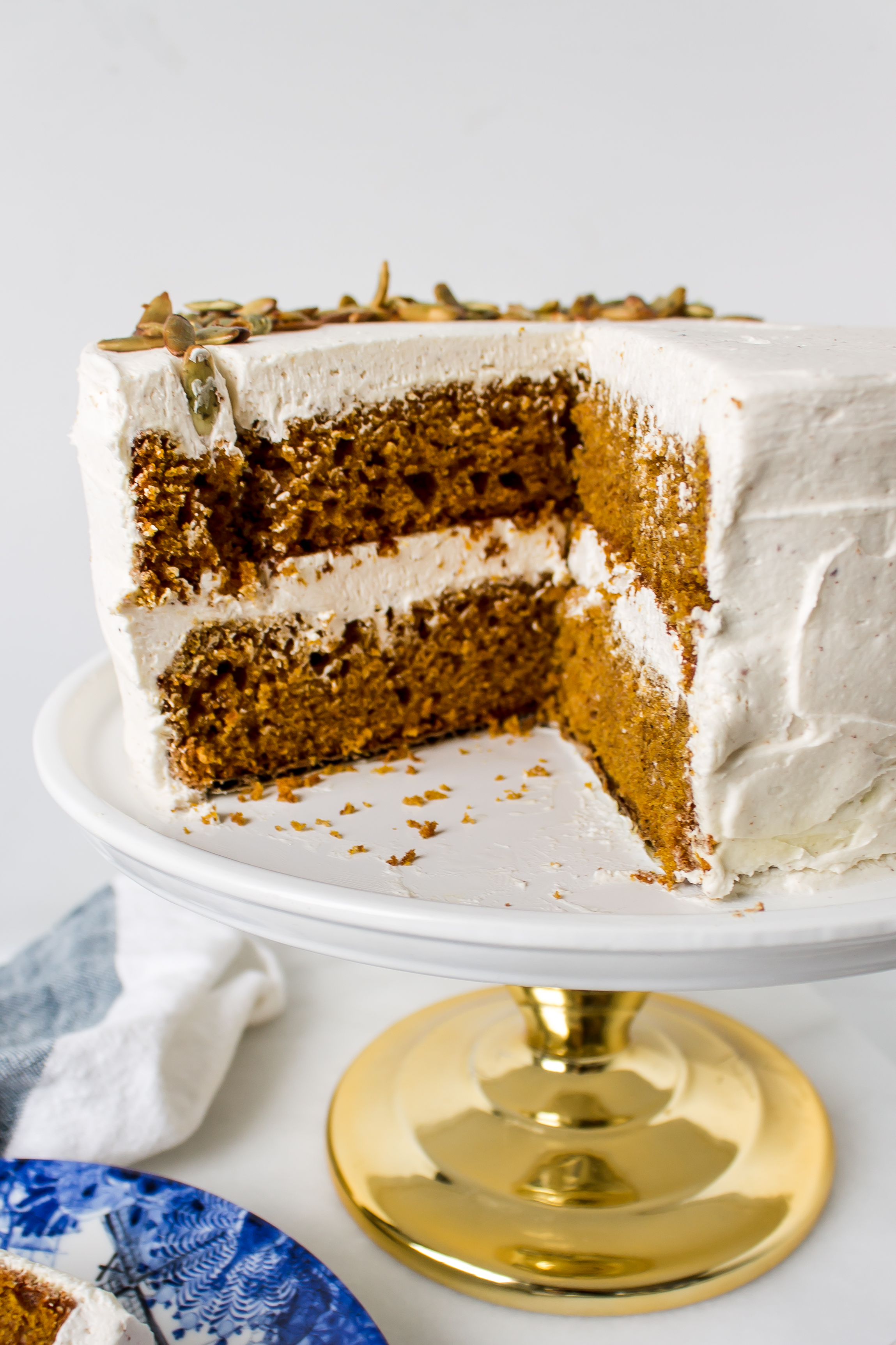 Pumpkin cake with brown butter frosting is perfect for fall. It is wonderfully moist and filled with fall spices and that amazing nutty browned butter flavor to create the ultimate delicious seasonal combination. | www.passthecookies.com