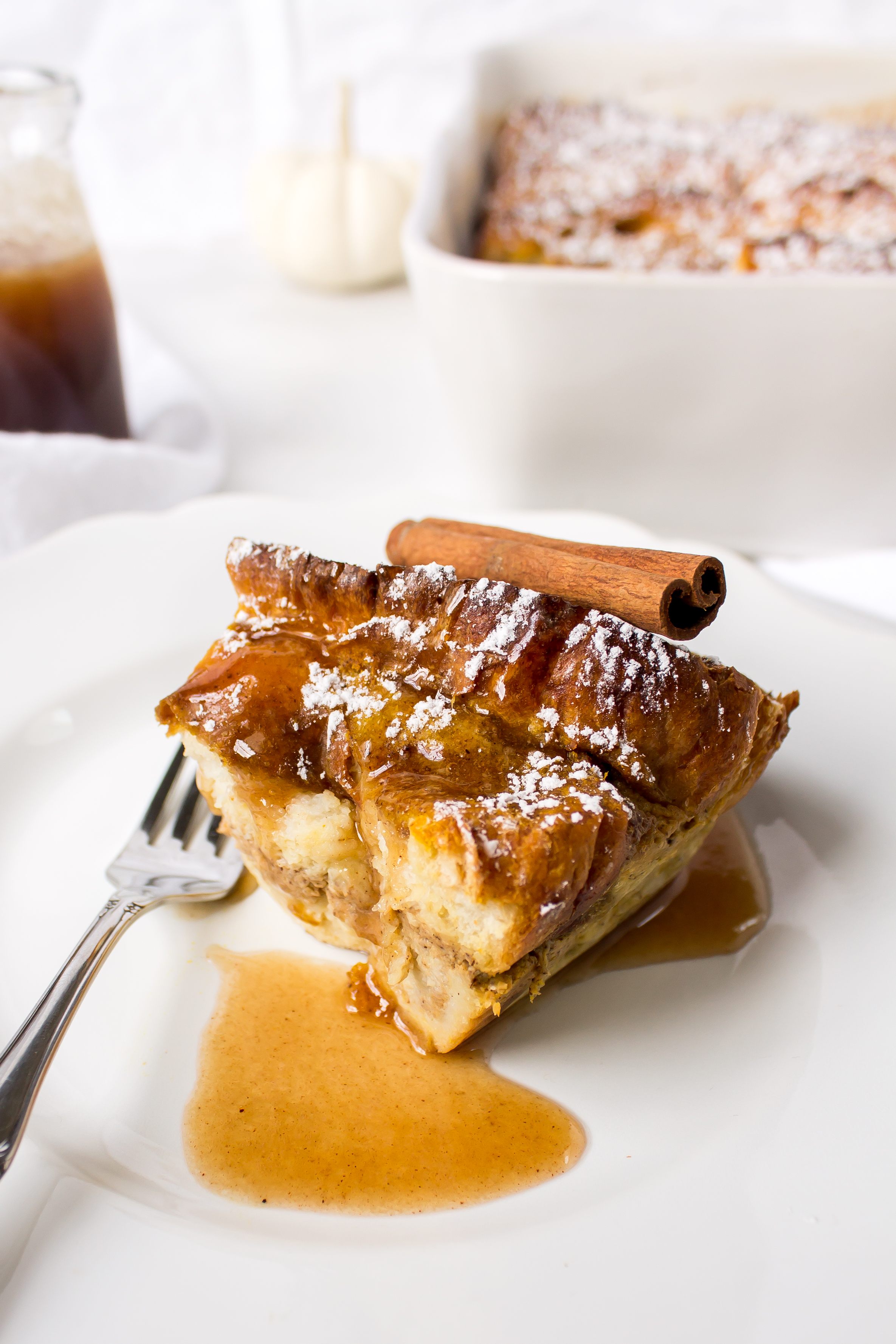 Pumpkin French toast casserole is easy to make ahead and warm up for a cold morning at home. It is almost custard-like and the apple cider syrup shouldn't be missed! | Pass the Cookies | www.passthecookies.com