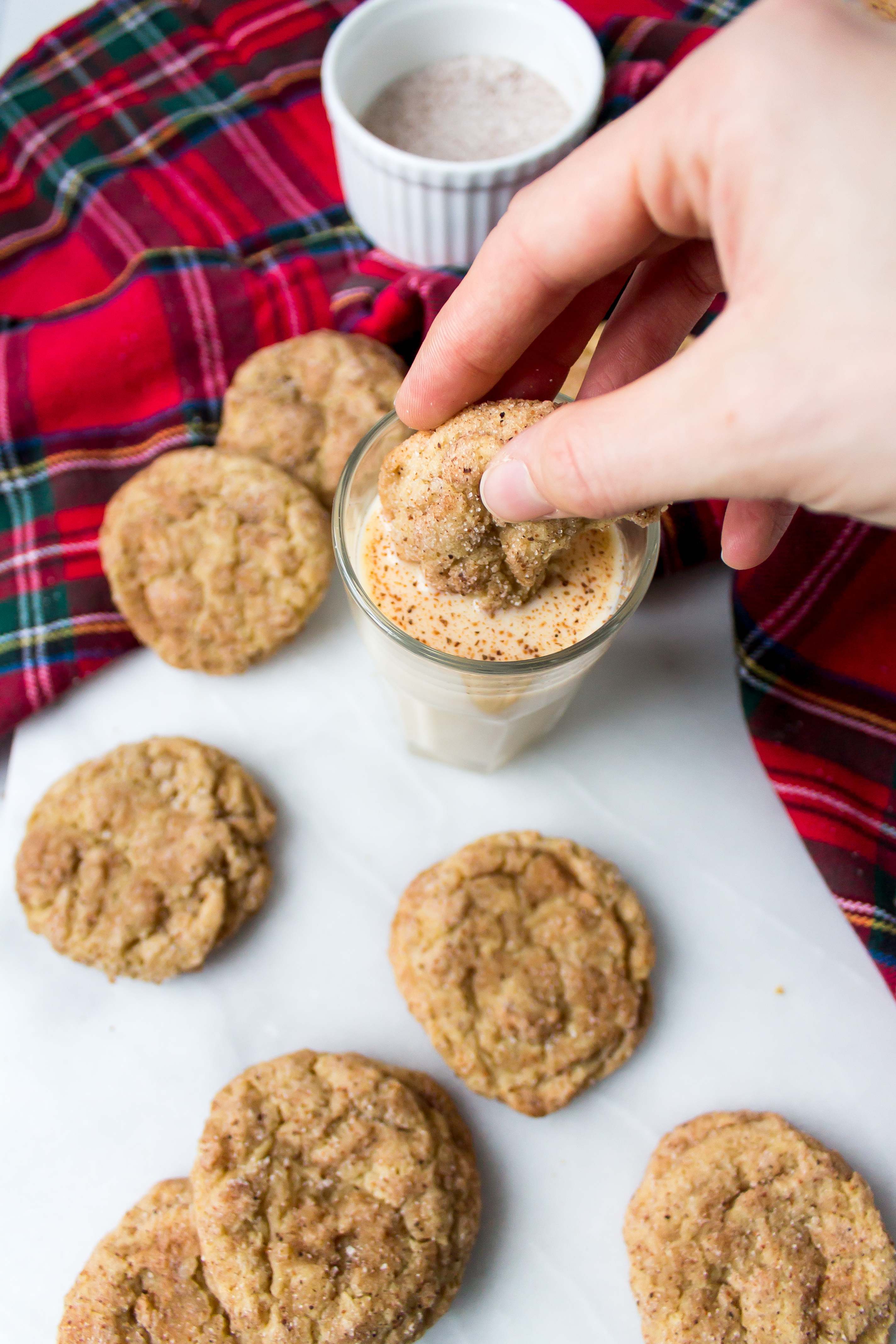 Eggnog snickerdoodles are soft, chewy, and filled with the familiar eggnog and nutmeg flavors. They are the perfect easy cookie to add to your plate of Christmas cookies this year! | Pass the Cookies | www.passthecookies.com